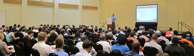 Mike Bellamy offering a tutorial on China sourcing to 300 professional buyer at a conferences in Miami.